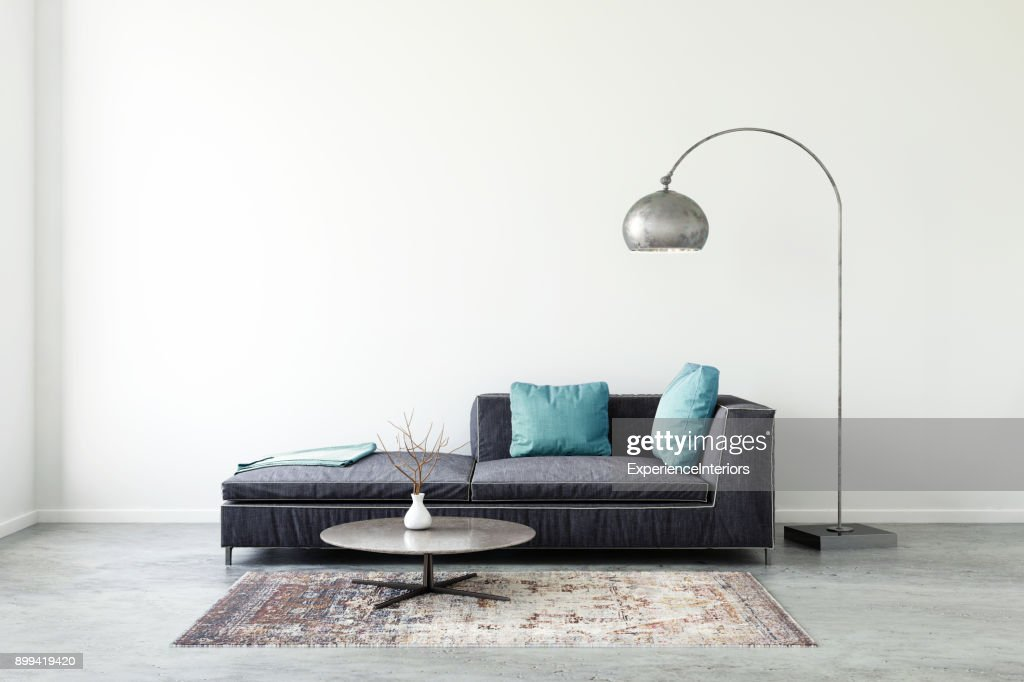 Pastel colored sofa with blank wall template : Stock Photo