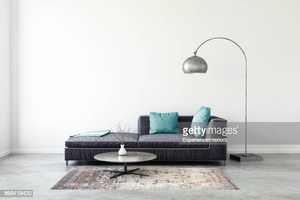 pastel colored sofa with blank wall template - lamp stock photos and pictures
