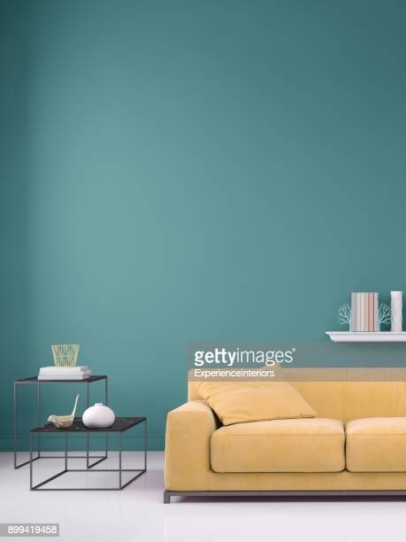 Sofá color pastel con plantilla de pared en blanco