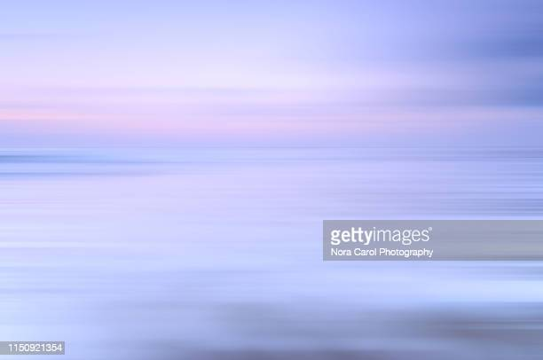 pastel colored sunrise, berawa beach canggu bali - pastel stock pictures, royalty-free photos & images