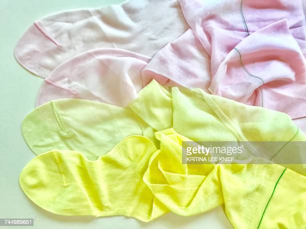 pastel colors - nylon feet stock photos and pictures