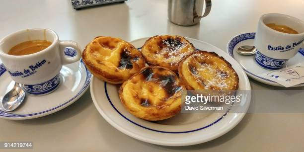 Pastel de nata a traditional Portuguese sweet egg pastry are served with coffee at the famous Pastéis de Belém bakery and cafe on October 1 2016 in...