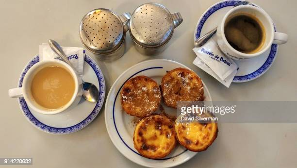 Pastel de nata a traditional Portuguese sweet egg pastry are served with coffee at the famous Pastéis de Belém bakery and cafe on October 2 2016 in...