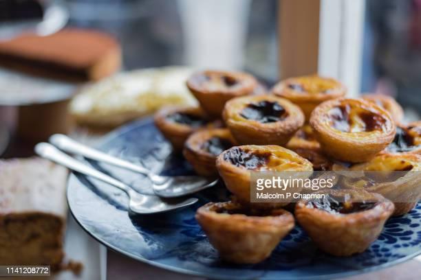 Pastel de Nata (Pastéis de nata or Pastel de Belém) are also commonly known as Portuguese Custard Tarts