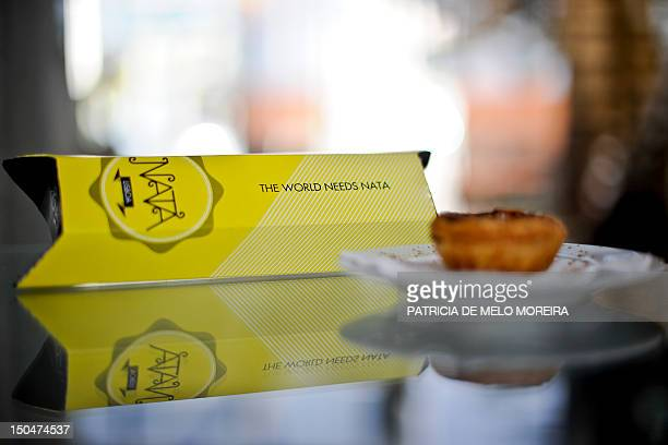A 'Pastel de nata' Lisbon's typical pastry is displayed next to a box from the brand Nata at the Nata's Cafe in Lisbon on August 10 2012 Under the...