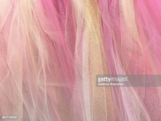 pastel pink and gold gauze fabric, full frame - frilly stock photos and pictures