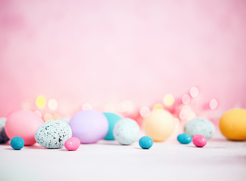 Pastel pink background with pastel eggs for Easter 930552956