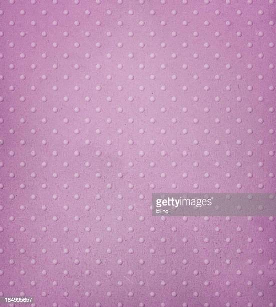 pastel pink paper with raised dots