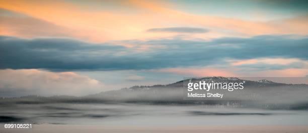 A pastel sunrise over a ski resort in winter