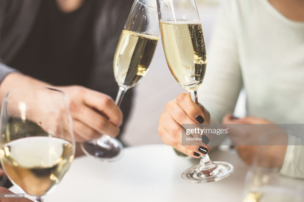 Pastels. Couple enjoying drinks : Stock Photo