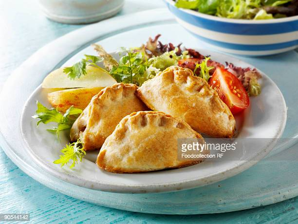 pasties with salad, close up - cornish pasty stock pictures, royalty-free photos & images