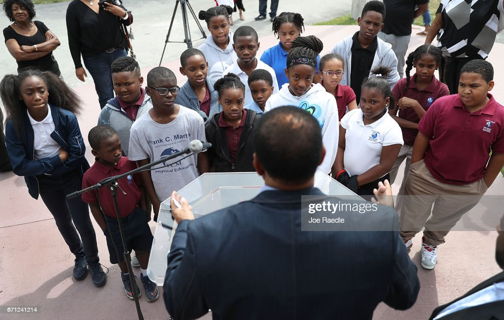 Pastor Alphonso Jackson, from the Second Baptist Church, explains to children from an After School Care Program the reason State Senator Frank Artiles resigned today from the Florida Senate on April 21, 2017 in Miami, Florida. Pastor Jackson addressed the media before speaking to the children about Mr. Artiles who resigned after he insulted two lawmakers at a Tallahassee bar with racists and sexist remarks.