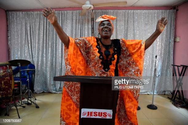 Pastor and songwriter Dupe Olulana sings in an empty Hosanna Christian Ministries, deserted by worshippers in compliance with measures to prevent the...