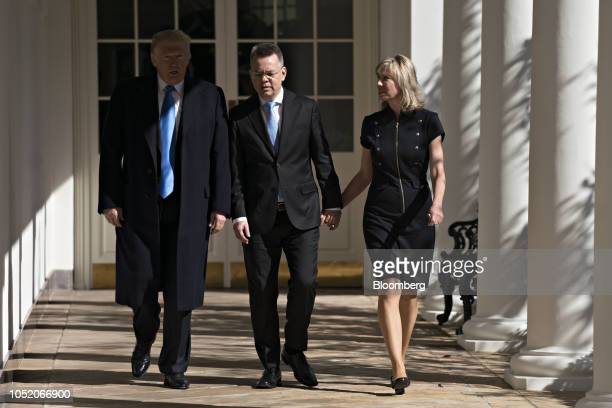US Pastor Andrew Brunson center and his wife Norine Brunson right walk with US President Donald Trump through the Colonnade of the White House in...