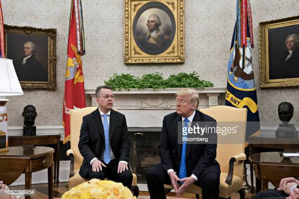 US Pastor Andrew Brunson left speaks as US President Donald Trump listens during a meeting in the Oval Office of the White House in Washington DC US...