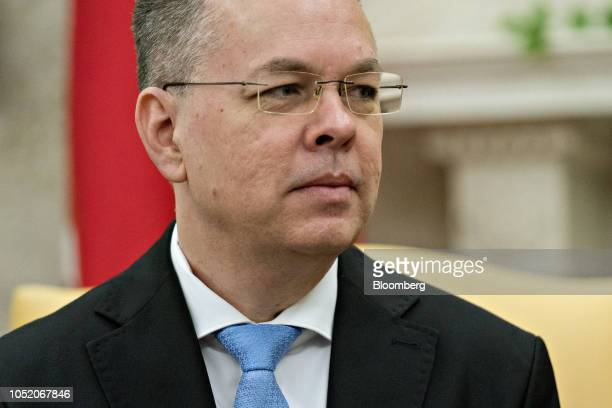US Pastor Andrew Brunson listens during a meeting with US President Donald Trump not pictured in the Oval Office of the White House in Washington DC...