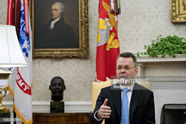 US Pastor Andrew Brunson speaks during a meeting with US President Donald Trump not pictured in the Oval Office of the White House in Washington DC...