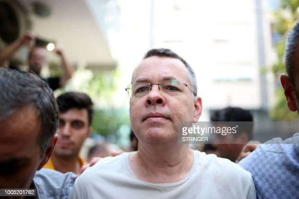 Pastor Andrew Craig Brunson escorted by Turkish plain clothes police officers as he arrives at his house on July 25 2018 in Izmir A Turkish court on...