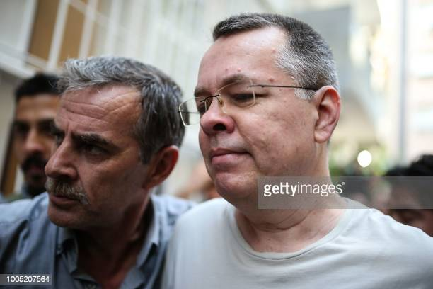 US pastor Andrew Craig Brunson escorted by Turkish plain clothes police officers arrives at his house on July 25 2018 in Izmir Turkey on July 15 2018...