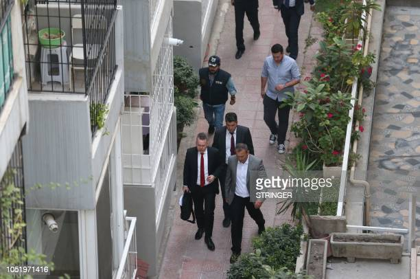 US pastor Andrew Craig Brunson is escorted to his home in Izmir on October 12 2018 after being freed following a trial in a court in Aliaga in...
