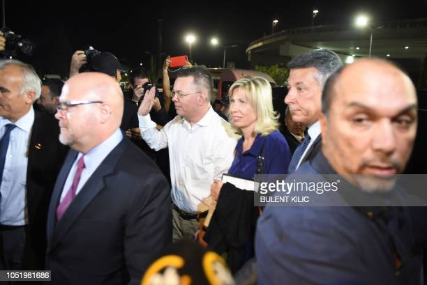 US pastor Andrew Craig Brunson waves as he arrives at Adnan Menderes airport in Izmir on October 12 2018 after being freed following a trial in a...
