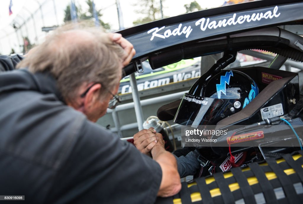 Pastor Bob Butcher says a prayer with Kody Vanderwal #32 the NASCAR K&N Pro Series West NAPA Auto Parts 150 on August 12, 2017 at Evergreen Speedway in Monroe, Washington.