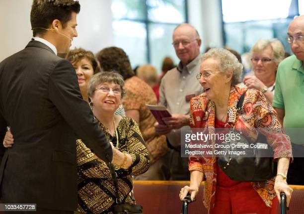 Pastor Bobby Schuller mingles after a Sunday morning service at Shepherd's Grove church in Garden Grove. Doris Carlton at right, of Anaheim Hills...