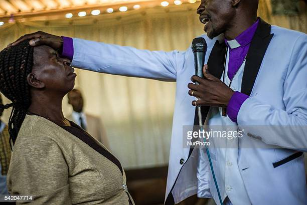 Pastor Chibwe Katebe exorcises the evil spirit from the body of a woman during a Sunday service at the House of Prayer for All Nations in...