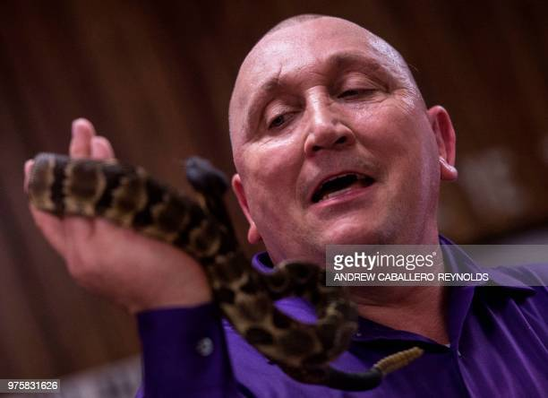 Pastor Chris Wolford holds a timber rattlesnake during a Pentecostal serpent handlers service at the House of the Lord Jesus church in Squire West...