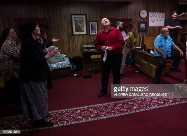 Pastor Chris Wolford prays during a Pentecostal serpent handlers service at the House of the Lord Jesus church in Squire West Virginia on May 26 2018...