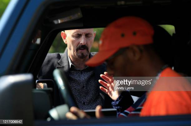 Pastor Chuck Salvo prays with congregants after the drivein service at On Fire Christian Church on April 05 2020 in Louisville Kentucky Due to the...