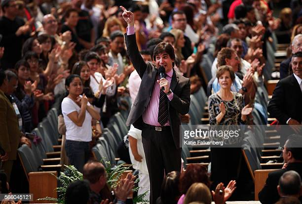 Pastor Dante Gebel preaches to the congregation before a song during the hispanic service at 1:00 pm at the Crystal Cathedral.