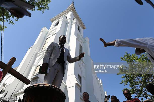 Pastor Dimas Salaberrios leads a group prayer in front of the Emanuel African Methodist Episcopal Church after a mass shooting at the church killed...