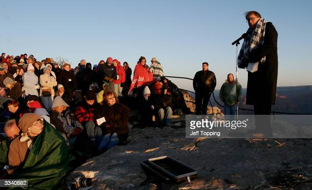 Pastor Edward Purkey gives the sermon to worshippers and visitors as they brave a zero degree wind chill to watch the sunrise from Mather Point...