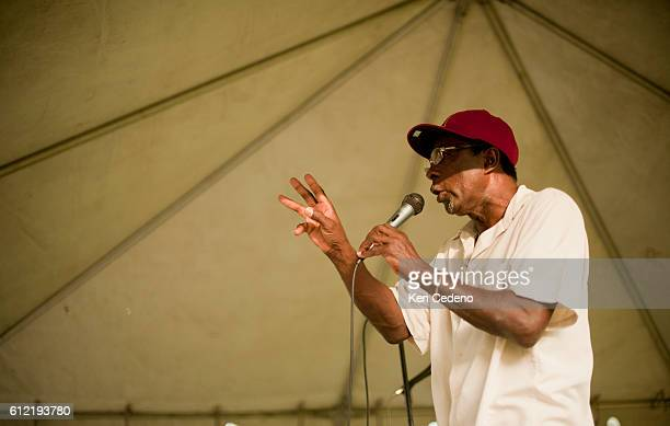 Pastor Ernest Dison of St Paul Church of God in Christ preaches during a tent revival in the lower 9th ward of New Orleans July 15 2010 Five years...