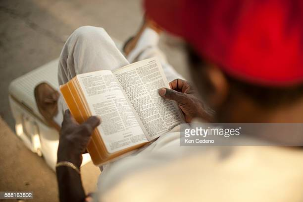 Pastor Ernest Dison of St Paul Church of God in Christ reads his bible during a tent revival in the lower 9th ward of New Orleans July 15 2010 Five...
