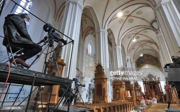 Pastor Evaldas Darulis is filmed as he leads the Palm Sunday Mass which is broadcast live at the empty St Francis of Assisi Roman Catholic Church due...