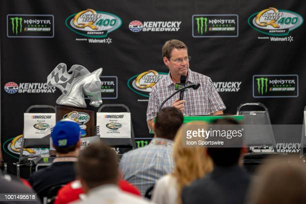 A pastor for Motor Racing Outreach speaks to drivers crew members officials and family before the Monster Energy NASCAR Cup Series Quaker State 400...