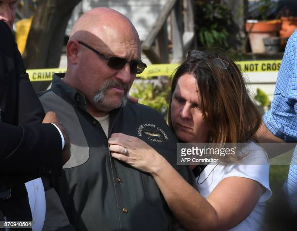Pastor Frank Pomeroy and his wife Sherri speak during a press conference at the entrance to the First Baptist Church after a mass shooting that...