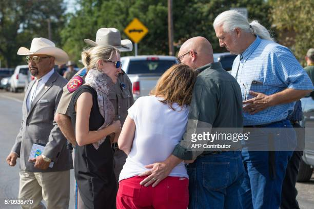 Pastor Frank Pomeroy comforts his wife Sherri following a press conference on November 6 2017 at the First Baptist Church in Sutherland Springs Texas...