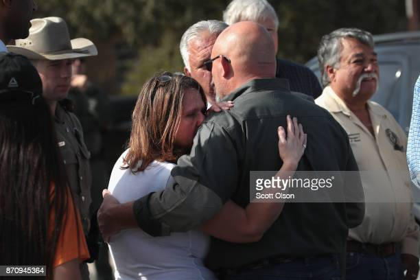 Pastor Frank Pomeroy hugs his wife Sherri after addressing the media near his First Baptist Church of Sutherland Springs on November 6 2017 in...