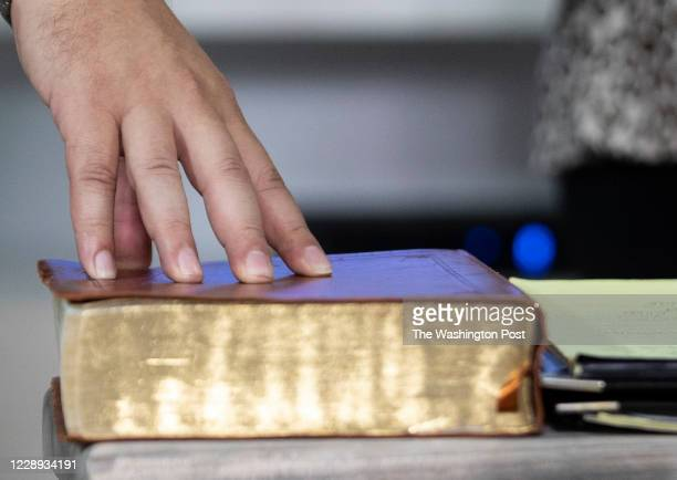 Pastor Gabriel Salguero, places his hand on the bible during his live stream sermon to the internet in Orlando, Fla., on Tuesday, August 2020. Latino...