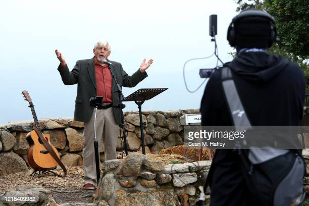 Pastor George Runyan gives a sermon during a sunrise Easter service at Mt Helix Park on April 12 2020 in San Diego California Due to fears of the...