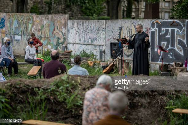Pastor holds a sunday mass in the garden outside the Chapel of Reconciliation , which is too small to hold a service providing social distancing,...