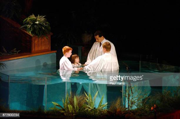 Pastor in a Megachurch baptizing children in a pool at the Southeast Christian church on June 2 2002 Southeast Christian Church Louisville Kentucky