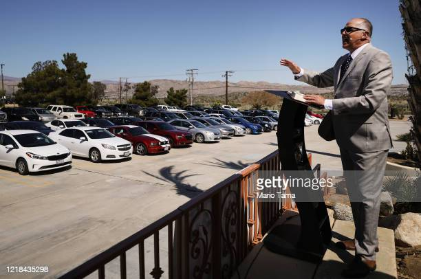 Pastor Jerel Hagerman conducts a drivein 'car church' Easter service in the parking lot of Joshua Springs Calvary Chapel amidst the coronavirus...