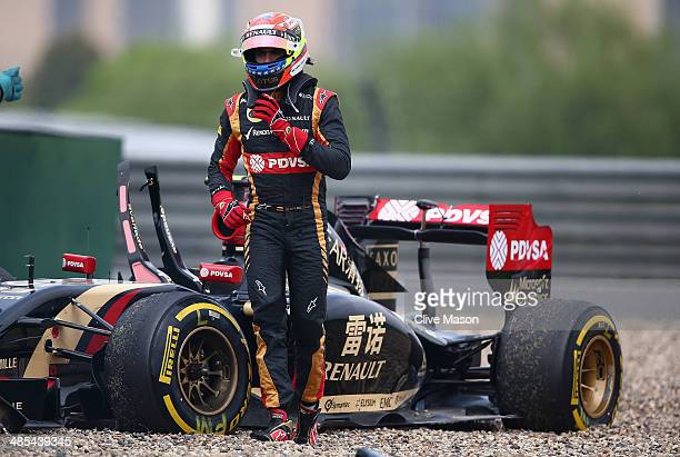 Pastor Maldonado of Venezuela and Lotus walks away from his car after crashing off the track during practice ahead of the Chinese Formula One Grand...