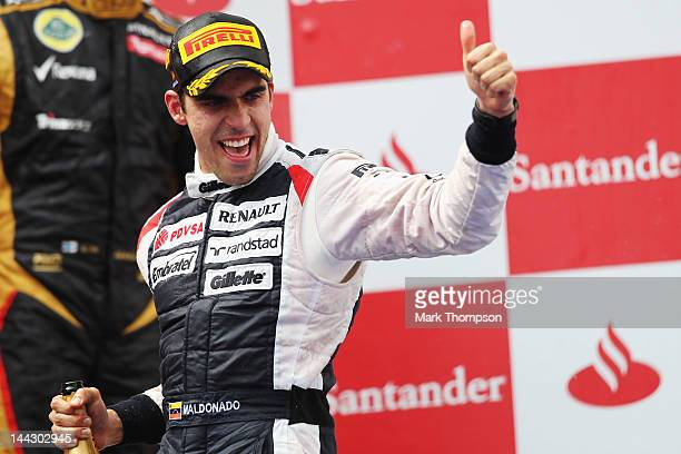 Pastor Maldonado of Venezuela and Williams celebrates on the podium after winning the Spanish Formula One Grand Prix at the Circuit de Catalunya on...