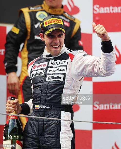 Pastor Maldonado of Venezuela and Williams celebrates on the podium after winning the Spanish Formula One Grand Prix at the Circuit de Catalunya on...