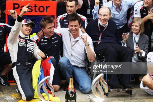 Pastor Maldonado of Venezuela and Williams celebrates with Team Principal Sir Frank Williams team mates in the pitlane after winning the Spanish...
